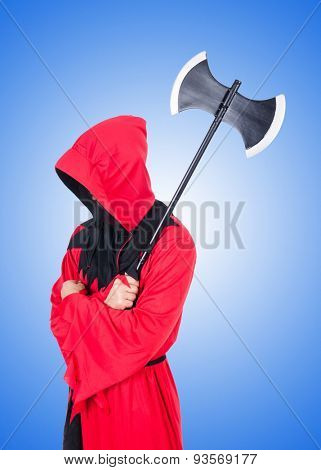 Executioner in red costume with axe against the gradient
