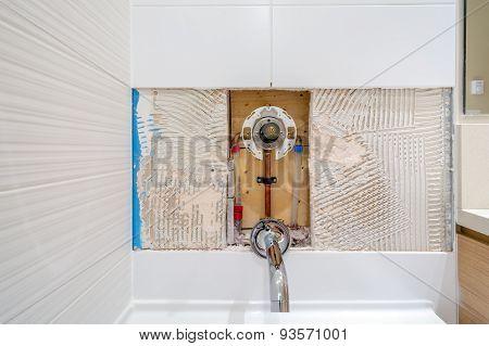 Faucet repair in the bathroom. Broken shower faucet.