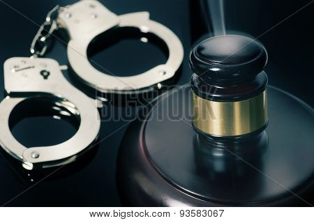 Legal judgement handed down - cuffs and hammer