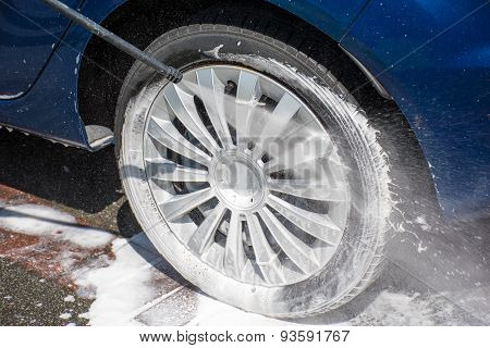 Washing A Dirty Wheel With A High Pressure Jet Wash