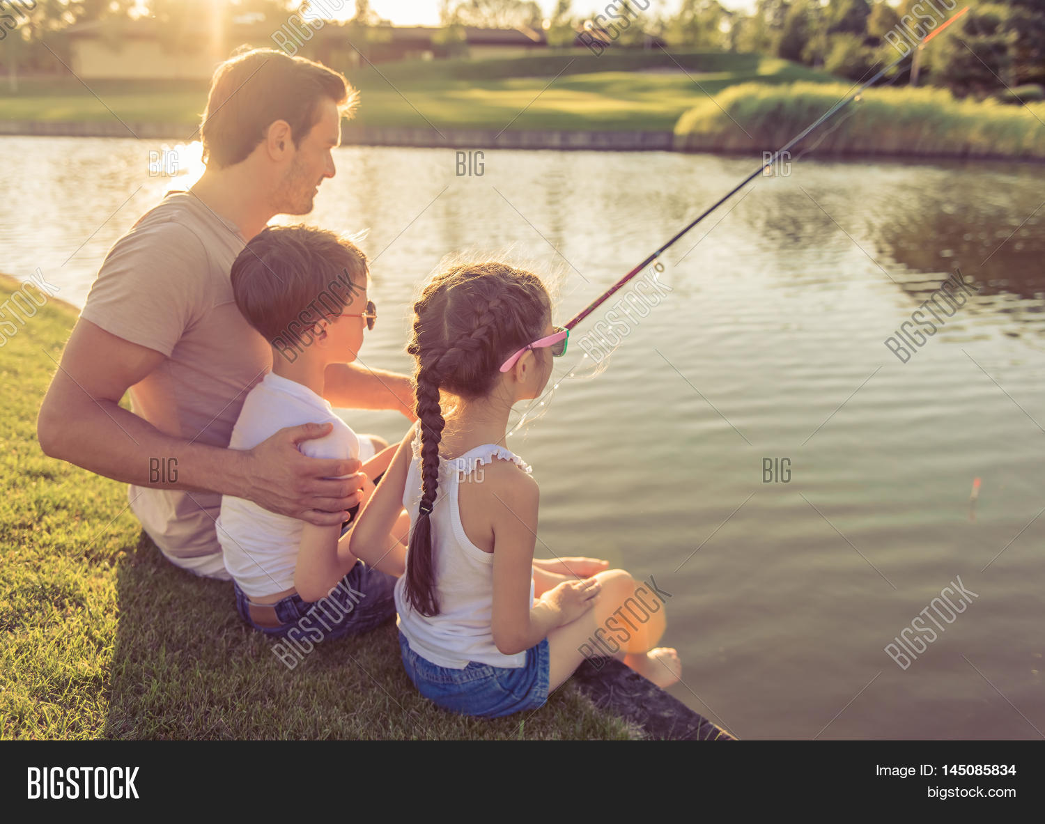Back view handsome father his image photo bigstock for Little kid fishing pole