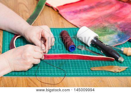 Craftsman Makes Leather Belt For New Embossed Bag