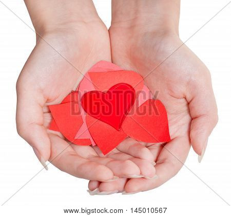 Heart Above Pile Of Paper Hearts On Female Palms