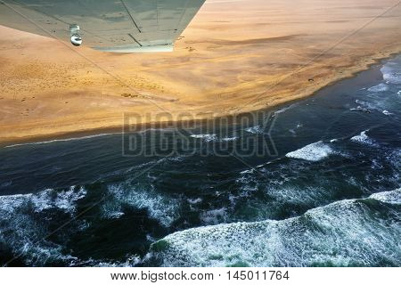 Flight over the Sceleton coast in Namibia where dunes of the Namib desert meet with Atlantic ocean Africa