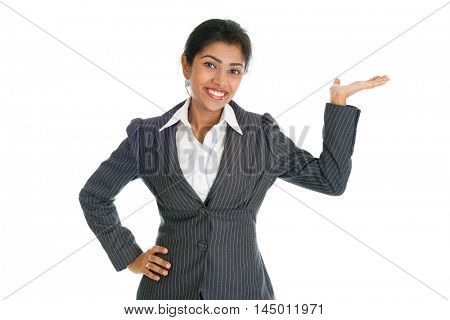 Black business woman in formalwear smiling and hand showing something, isolated on white background.