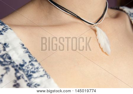 Women's neck with a decoration of a seashell