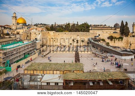 The area in front of the greatest shrine of Judaism. Autumn holiday Sukkot. The Western Wall of the Temple is preparing for evening prayer