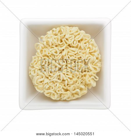 Instant noodles in a square bowl isolated on white background