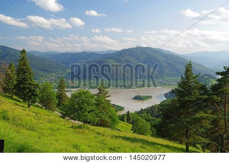 Summer landscape with Bistrita river during flood