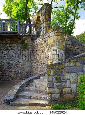 Ancient stone stairs on the wall in the city