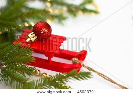 Christmas toy and fir tree on a white background