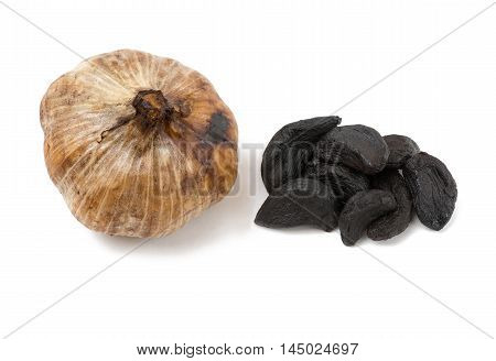 Whole bulb of home fermented Black Garlic with cloves latest wonder food rich in antioxidants vitamins and minerals. On a isolated white background