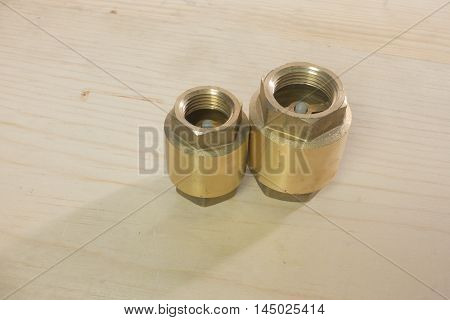 Check valve to the water on wooden background