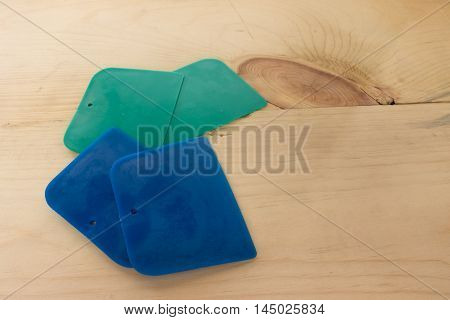 plastic putty spattles on wood in thai