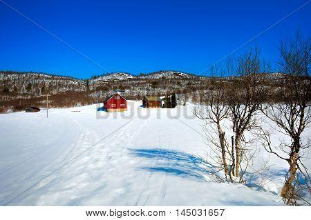 A Norwegian farm in a white winter landscape