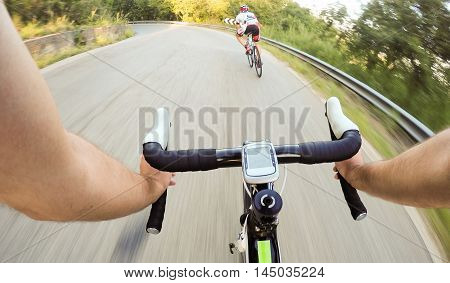 Couple of Cyclist during a cycling road race. Pov, Original Point of View