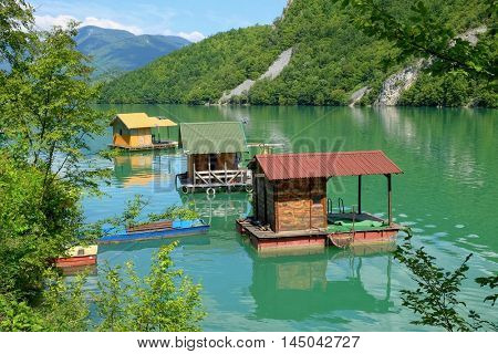 three floating houses on Drina River, Serbia