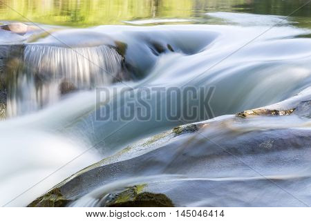 The water flow in the mountain river. Mountain river in the Carpathians. Ukraine.