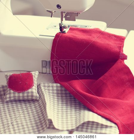 background with sewing fabric on the sewing machine / sewing fabric in home hobby
