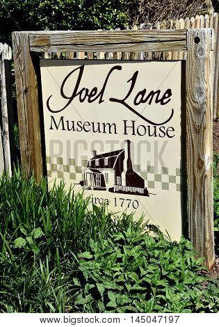 Raleigh North Carolina - April 18 2016: Quaint sign at the c. 1770 Joel Lane Museum House