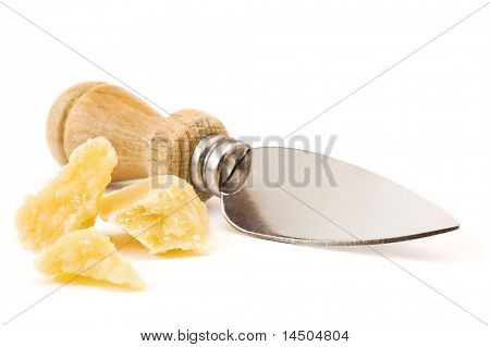 Parmesan cheese flakes and the traditional knife for this typical hard Italian cheese isolated on white background