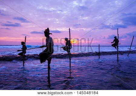 AHANGAMA - NOVEMBER 27 : Still fisherman's fishing fish at sunset on November 27 2015 in Ahangama Sri Lanka