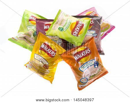SWINDON UK - AUGUST 27 2016: Bags of Wlakers new Flavour crisps isolated on a white background. Walkers is a British snack food manufacturer