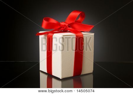 Little white box with red ribbon to celebrate a special Christmas, birthday or any kind of holiday!