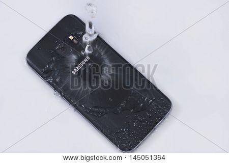 Water splash on Samsung Galaxy S7. Testing the Galaxy S7 water resistance IP68 standard