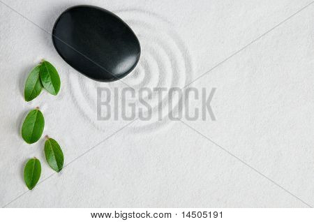 Zen garden background with copy space for your text. Pebble and leaf for relax and meditation.