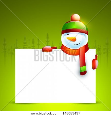 Cute smiling snowman holding blank board on fir trees decorated green background for Merry Christmas celebration.