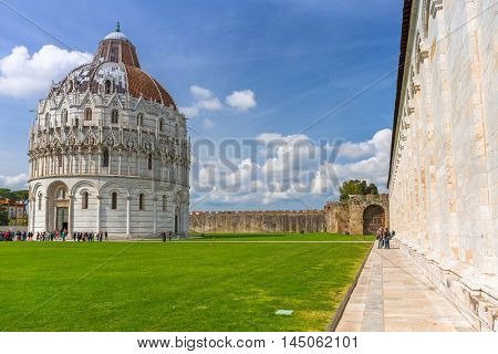 PISA, ITALY - APRIL 11, 2015: Baptistery building at the Leaning Tower of Pisa, Italy Pisa is a city in Tuscany known worldwide for the Leaning Tower, one of the biggest landmark.