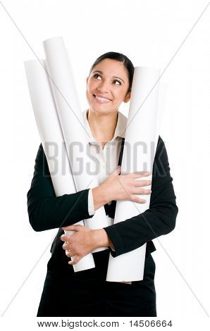 Beautiful young architect in suit dreaming while holding her plans isolated on white