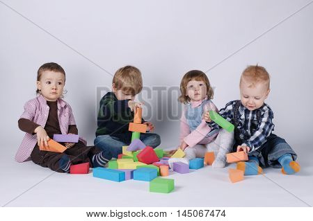 photo of happy children playing with cubes