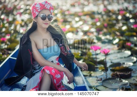 Portrait Of A Beautiful Fashion Girl Wear Traditional On Boat In Lake Of Lotus Field...