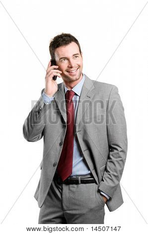 Young smiling businessman talking on mobile isolated on white background