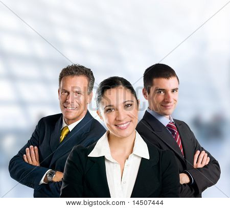Multi aged happy business team with woman and men in a modern office with copy space