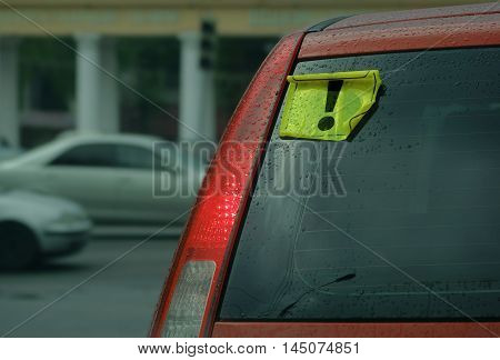 Danger sign on a red car. L plate