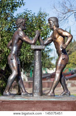 Sochi, Russia - February 11, 2016: Ancient Greek Olympians. Arm wrestling The sculptural composition