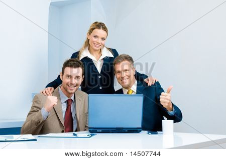 Happy successful business team celebrate in their modern office