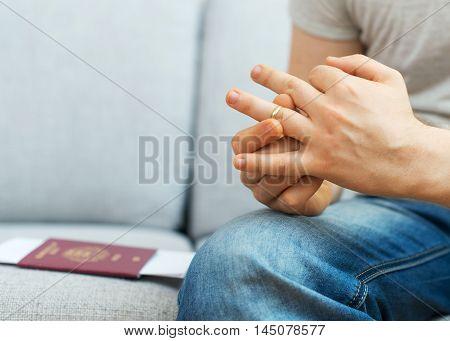 Divorce Concept. Man Taking Off Wedding Ring.