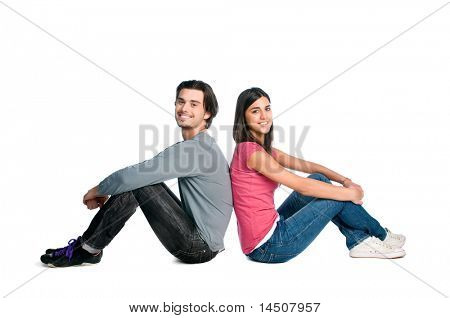 Happy young beautiful latin couple relaxing together while sitting isolated over white background