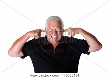 A man plugs his ears with his fingers to shut out unwanted noise. isolated on white with room for text.