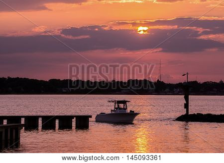 Fishing boat returning home on the Chesapeake Bay at sunset