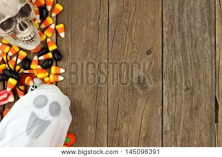 Halloween Candy And Decor Side Border Against A Rustic Wood Background