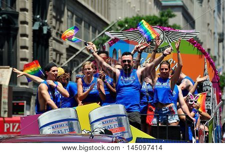New York City - June 29 2013: Exuberant riders on the Kiehl's cosmetics company float at the 2013 Gay Pride Parade on Fifth Avenue