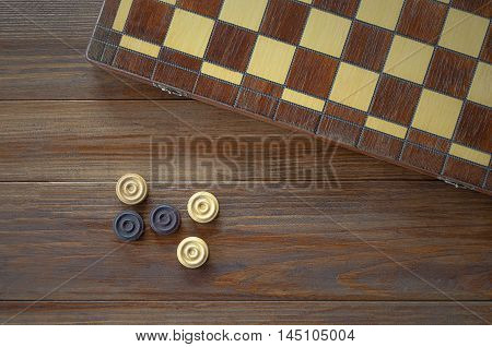 Game Checkers draughts on a table wooden background