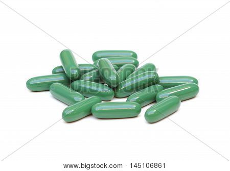 Green Chlorophyll tablets isolated on white background