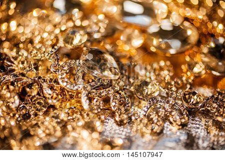 Luxury fashion precious background of golden jewelry