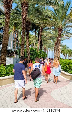 MIAMI BEACH, USA - AUGUST 6, 2016 : Young people at the boardwalk next to South Beach on a sunny summer day